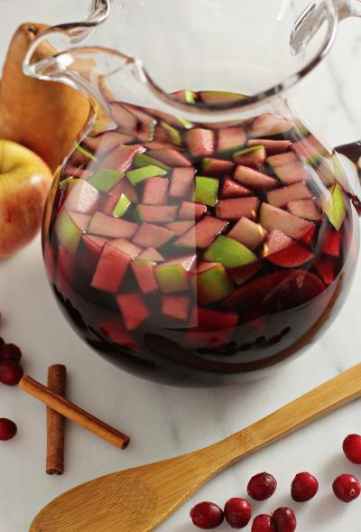 A glass pitcher of Pomegranate Cranberry Sangria.