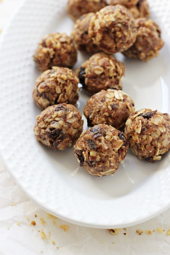 These oatmeal raisin energy bites are perfect for snacking! Made with almond butter, oats and walnuts, they are a healthier treat that tastes like an oatmeal raisin cookie! Gluten free and no bake!