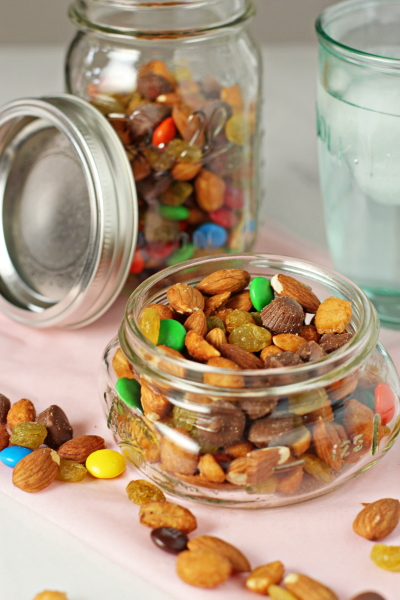 Two glass jars filled with Homemade Trail Mix with Chocolate.