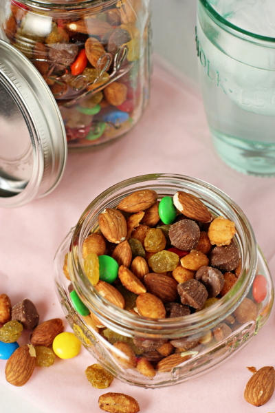 An open glass jar of Chocolate Trail Mix.