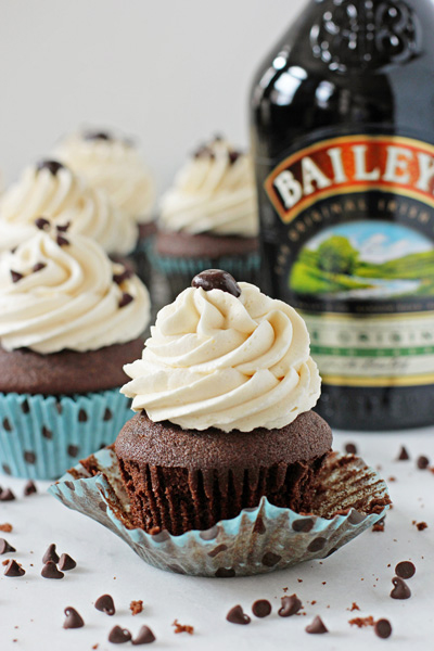 An unwrapped Baileys Irish Cream Cupcake on a marble surface.