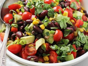 This easy and healthy mexican bean salad is fantastic for picnics and potlucks! Packed with two kinds of beans, crunchy veggies, creamy avocado and a dreamy lime chipotle dressing. Gluten and dairy free, with a vegan option included!