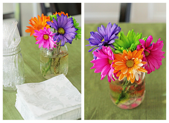 Colorful flowers set up on a dining room table.