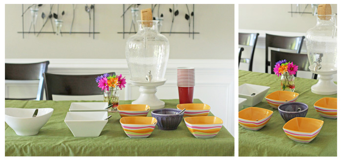A dining room table with empty serving dishes for party prep.