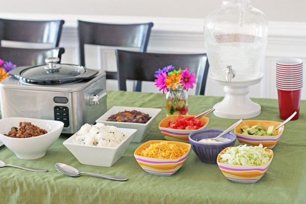 A Taco Bar set up on a dining room table.