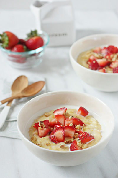 Two white bowls filled with Strawberries and Cream Breakfast Polenta.