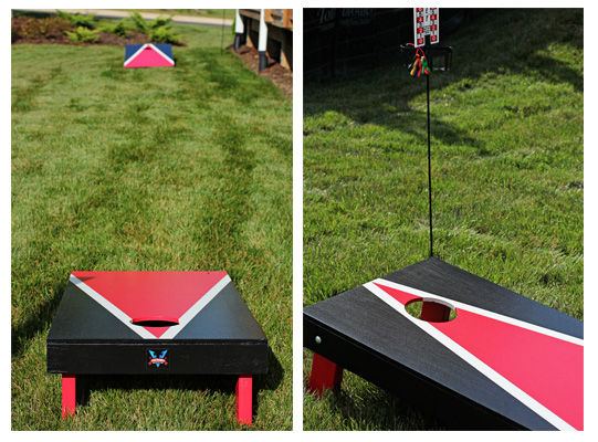 Two cornhole boards outside on a lawn.