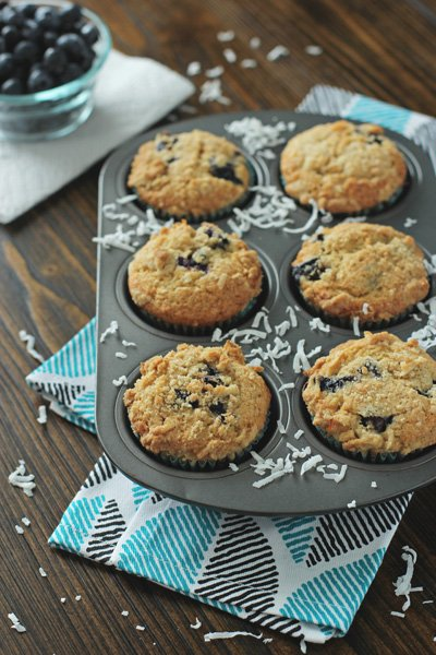 A baking pan filled with Blueberry Coconut Muffins.