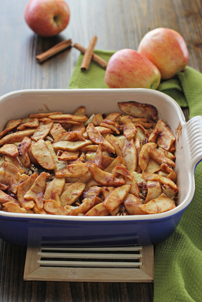 A purple baking dish filled with Overnight Apple Cinnamon French Toast.
