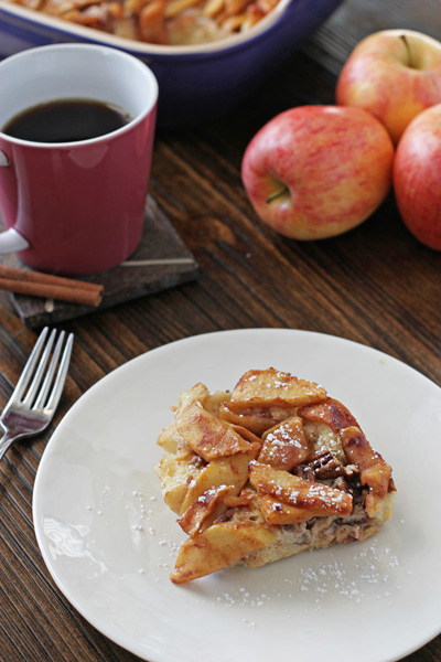 A serving of Baked Apple Cinnamon French Toast on a plate with coffee.