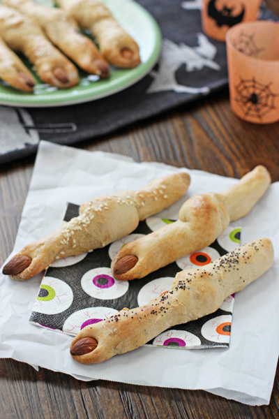 Several Halloween Breadstick Fingers on festive napkins.