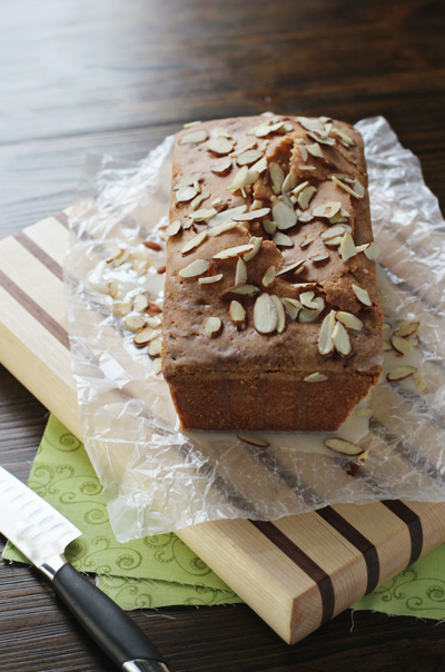 An Almond Pound Cake on a wooden cutting board.