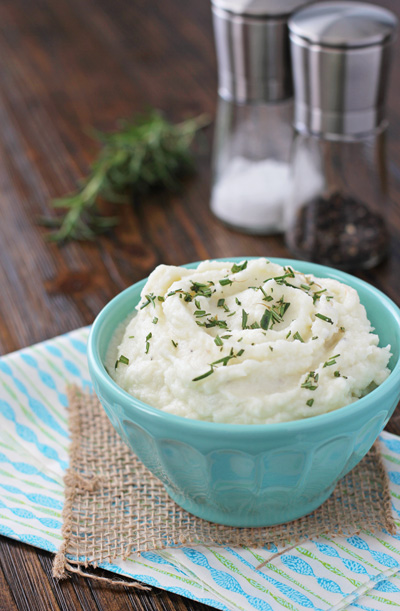 A bowl filled with Mashed Cauliflower with Cream Cheese.