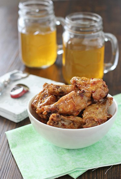 A white bowl filled with Honey Chipotle Chicken Wings.