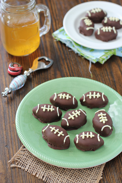 A green plate filled with Football Chocolate Balls.