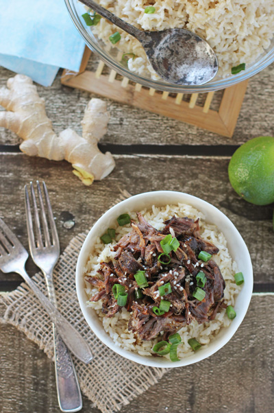 Slow Cooker Asian Short Ribs over rice in a white bowl.