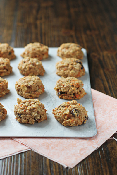A baking sheet filled with Healthy Carrot Cookies.
