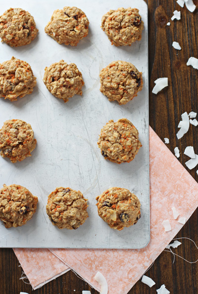 A baking sheet filled with Carrot Oatmeal Cookies with one missing.