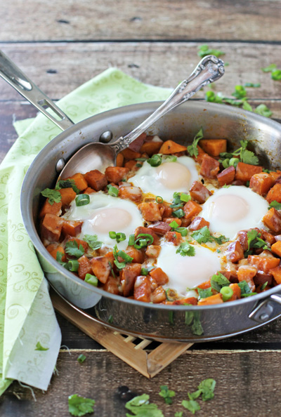 A Southwest Sweet Potato Breakfast Skillet on a wooden surface.
