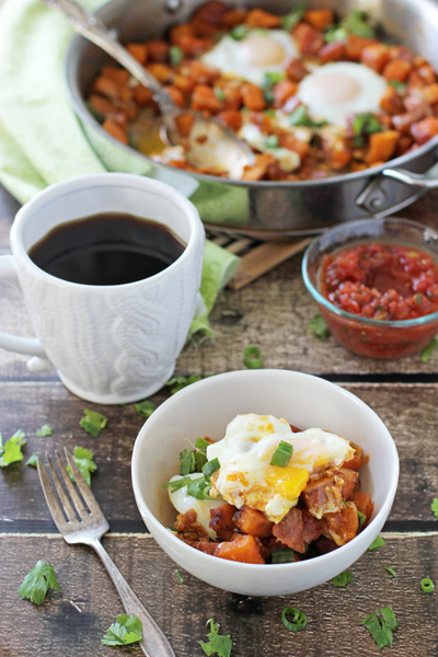 A serving of Southwest Breakfast Skillet in a white bowl with coffee.