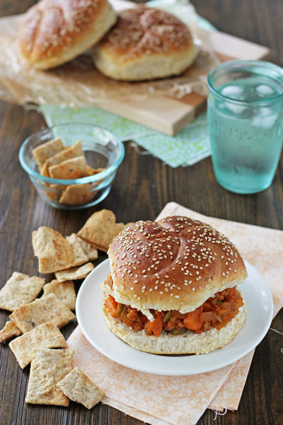 A Vegetarian Sloppy Joe on a white plate with chips to the side.