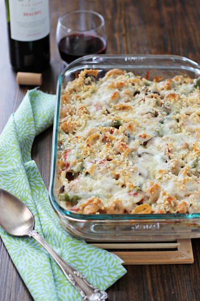 A glass baking dish filled with Baked Asparagus Mushroom Pasta.