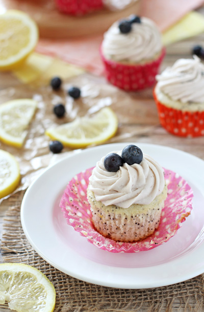 Lemon Poppy Seed Cupcakes with Blueberry Cream Cheese Frosting | cookiemonstercooking.com