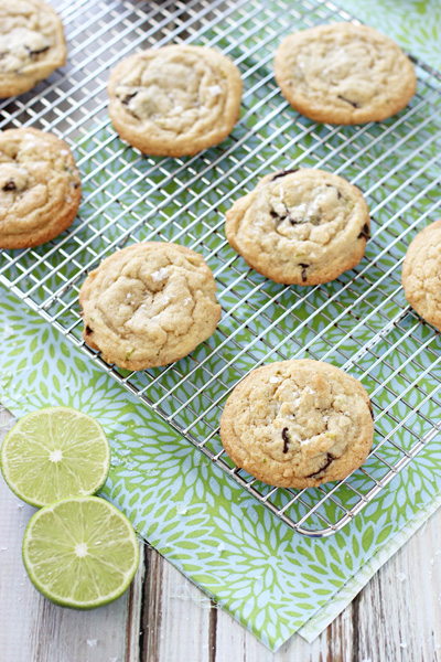Several Lime Dark Chocolate Chunk Cookies on a wire cooling rack.