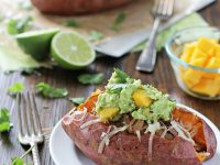 Loaded Pulled Pork Sweet Potatoes with Mango Guacamole | cookiemonstercooking.com