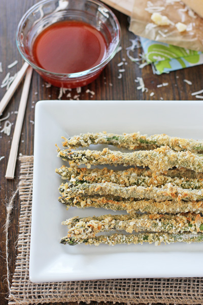 A white platter filled with Panko Crusted Asparagus.