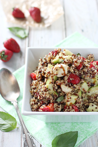 A white serving dish filled with Strawberry Quinoa Balsamic Salad.
