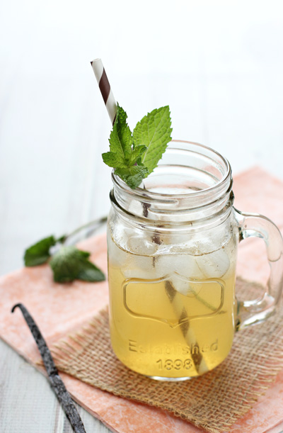 A glass of Naturally Sweetened Iced Tea Lemonade with fresh mint.