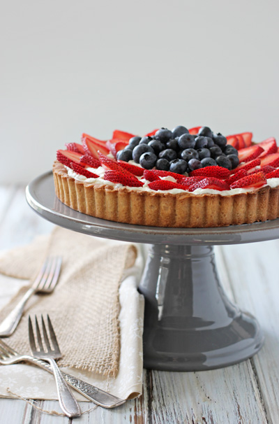 A grey cake stand with a Berry Mascarpone Tart.