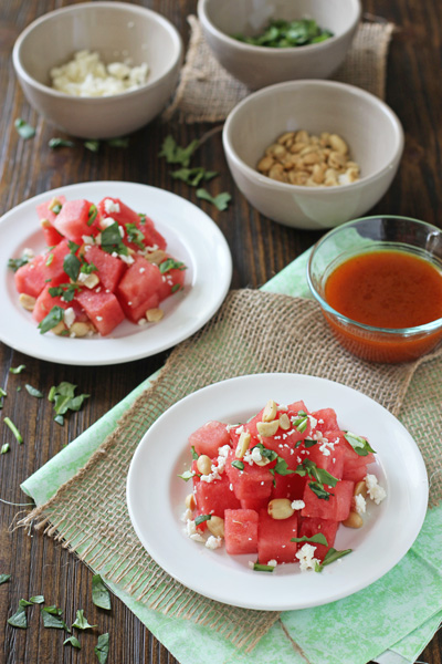 Two white plates filled with Watermelon Salad.