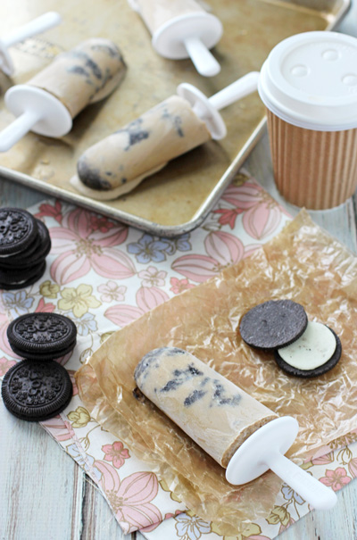 Coffee Cookie Popsicles on wax paper and a baking sheet.