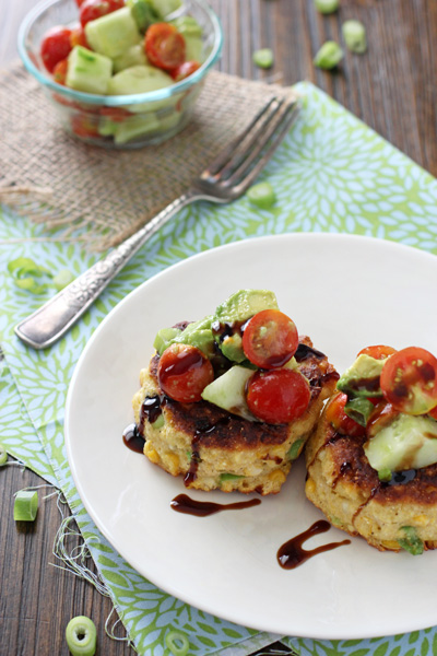 Two Healthy Corn Fritters on a white plate.