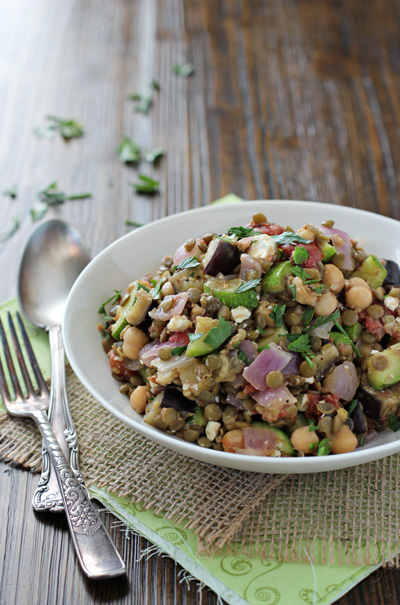 A white bowl filled with Chickpea and Lentil Salad.