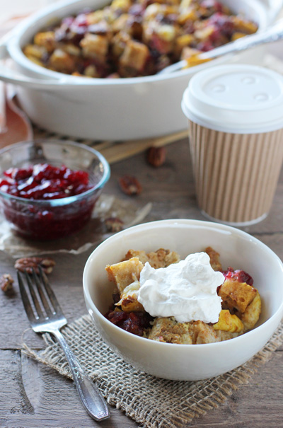 A white bowl with a serving of Pumpkin Breakfast Bake with coffee to the side.