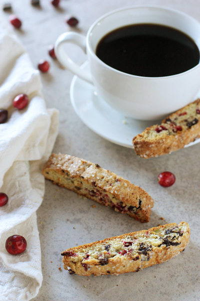 Three Cranberry Pistachio Biscotti and a cup of coffee.