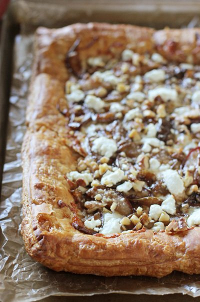 A baking sheet with a full Pear and Goat Cheese Tart.