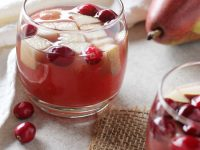 Sparkling winter champagne sangria! A festive, make-ahead holiday drink! With white wine, champagne, cranberry juice, fresh fruit and a spiced simple syrup!
