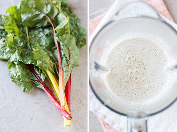 A bunch of swiss chard and a blender with cashew cream.
