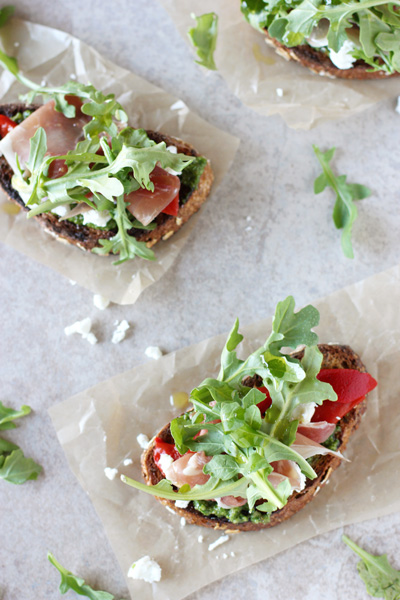 Several Italian Open Faced Sandwiches on parchment paper.