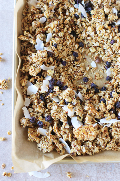 A parchment lined baking sheet filled with Quinoa Granola.