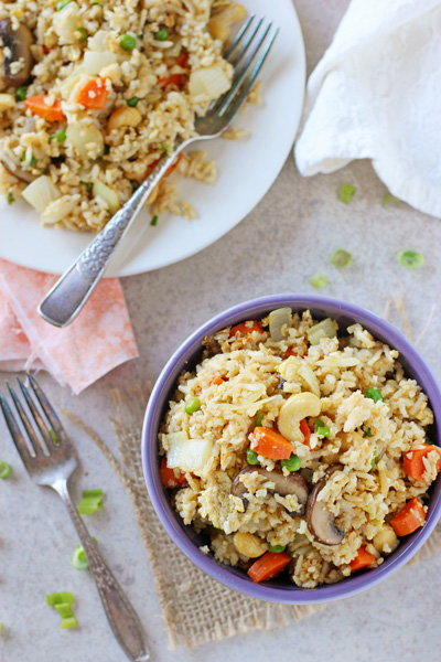 A bowl and plate filled with Vegetable Fried Rice.