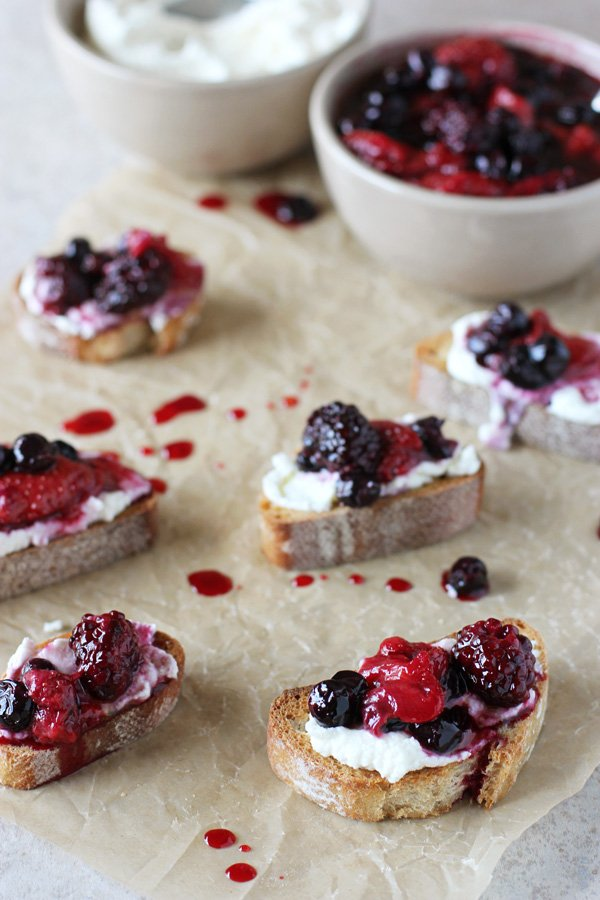 Recipe for roasted berry and ricotta crostini. A simple, yet impressive dish perfect for brunch or even dessert!