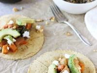 Recipe for lentil, sweet potato and goat cheese tacos. Filled with sautéed sweet potatoes and carrots, and topped with walnuts, goat cheese and avocado!