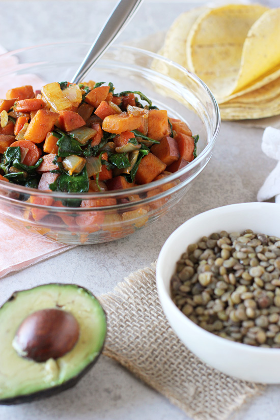 Roasted sweet potatoes and cooked lentils in small bowls for Vegetarian Lentil Tacos.