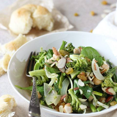 Recipe for a simple roasted spring veggie salad. Filled with asparagus and broccoli and a creamy tahini dressing. With golden raisins and sliced almonds!