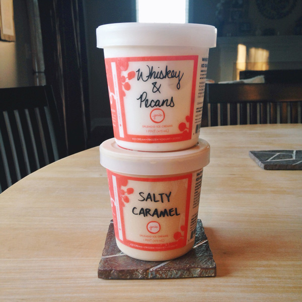 Two pints of Jeni's ice cream stacked on each other.
